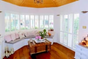Living Room Sunroom White Shutters